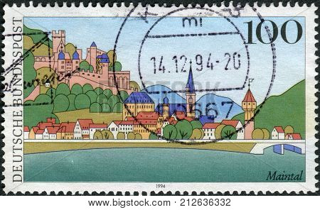 GERMANY - CIRCA 1994: Postage stamp printed in Germany shows a view of the city Maintal (Wertheim) circa 1994