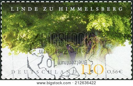 GERMANY - CIRCA 2001: Postage stamp printed in Germany shows Himmelsberg Lime Tree Natural Monument (age 750 years) circa 2001