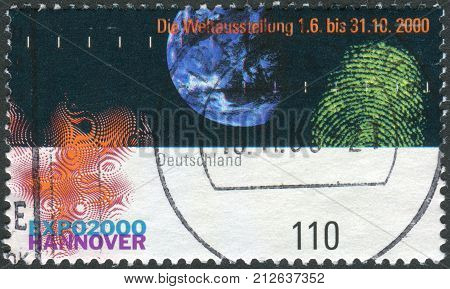 GERMANY - CIRCA 2000: Postage stamp printed in Germany dedicated to the EXPO 2000 Hannover depicts Earth fingerprint and emblem circa 2000