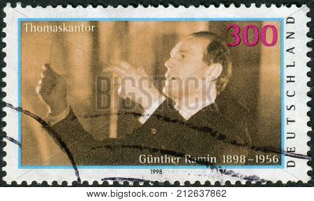 GERMANY - CIRCA 1998: Postage stamp printed in Germany shows the Organist and Choir Leader Gunther Ramin circa 1998