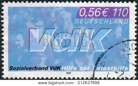 GERMANY - CIRCA 2001: Postage stamp printed in Germany dedicated to the 50th anniversary of the Association of Disabled War Veterans circa 2001