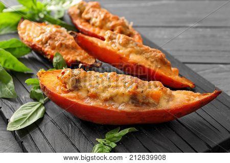 Wooden board with yummy stuffed sweet potato