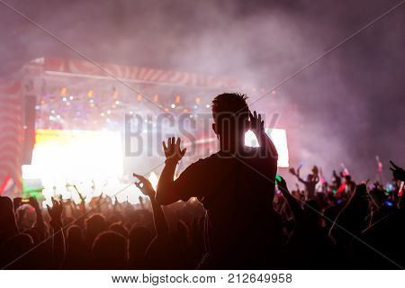 Slhouette of young man on concert, big festival event