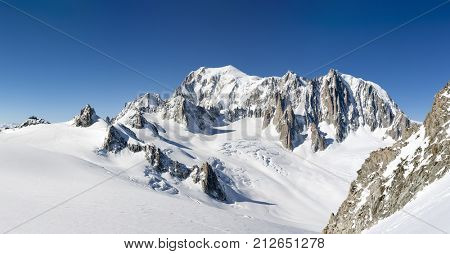 Mont Blanc, east face. Extra-large panorama of Mont Blanc Massif peaks and glaciers in a sunny winter day. Chamonix, France, Europe.