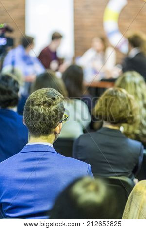 Conference and Mediation at The Round Table.Group of Professional Mediators Presenting at the Round Table on Stage Before the Audience.Vertical Image