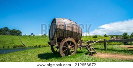 Wine Barrel In Green Grass Field