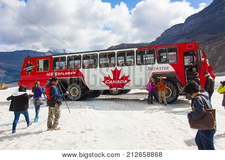 Athabasca August 2015 In this period of no snow tourists visit the Athabasca Glacier in Athabasca with this big truck as it is the only truck able to do it and it is a great experience to do once in life.