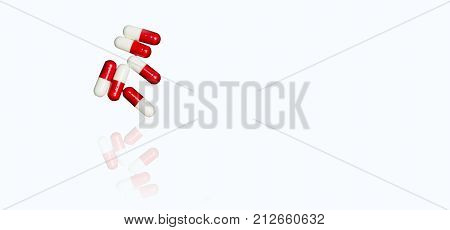 Red white antibiotic capsules pills isolated on white background with copy space and clipping path. Drug resistance antibiotic drug use with reasonable concept.