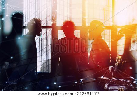 Business people work together in office with network connection effect. Concept of teamwork and partnership. double exposure
