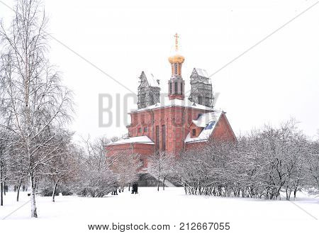 Church in microdistrict Ribatskoe on the outskirts of St. Petersburg at cloud winter day Russia. poster