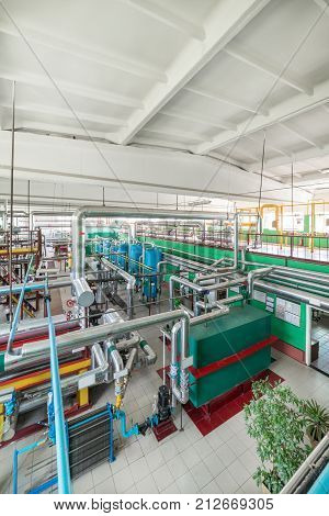 Modern boiler room, steam and hot water generation. Complex system of tanks, pipelines, pumps and valves.