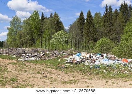 Garbage dump in the forest road. Vologda Region, Russia