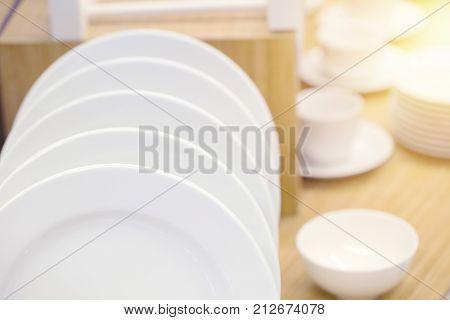 clean white ceramic kitchen dish ware decorative on wood