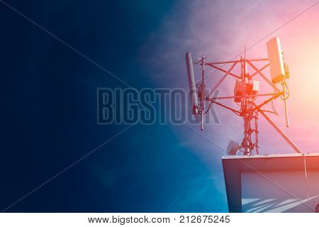 Mobile phone Signal tower cell site of Digital 4G system on roof top with space for text
