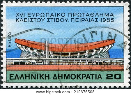 GREECE - CIRCA 1985: A stamp printed in Greece dedicated to the European Indoor Athletics Championships shows the Palais des Sports New Phaleron Athens circa 1985