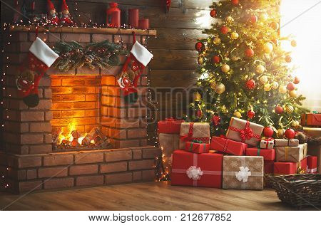 interior christmas. magic glowing tree fireplace and gifts