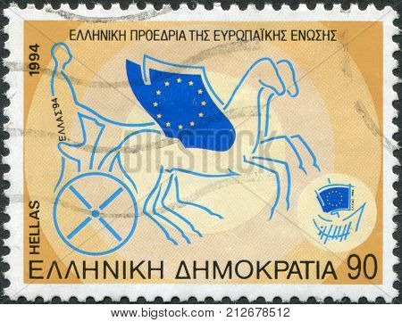 GREECE - CIRCA 1994: Postage stamps printed in Greece, dedicated to the Greek Presidency of European Community Council of Ministers, shows Winged chariot driven by Greece, circa 1994
