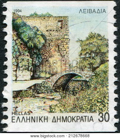 GREECE - CIRCA 1994: Postage stamps printed in Greece shows Lebadea medieval bridge tower of catalanian castle Krias springs circa 1994