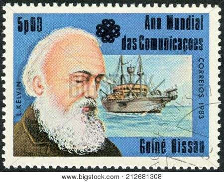 GUINEA - BISSAU - CIRCA 1983: A stamp printed in Guinea-Bissau dedicated to the World Communications Year shows a Scots-Irish mathematical physicist and engineer William Thomson 1st Baron Kelvin circa 1983
