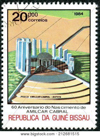 GUINEA - BISSAU - CIRCA 1984: A stamp printed in Guinea-Bissau dedicated to 60th Anniversary of Birth Amilcar Cabral shows the Memorial building Bafata circa 1984