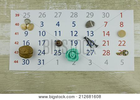 Leaf of the calendar with marks objects