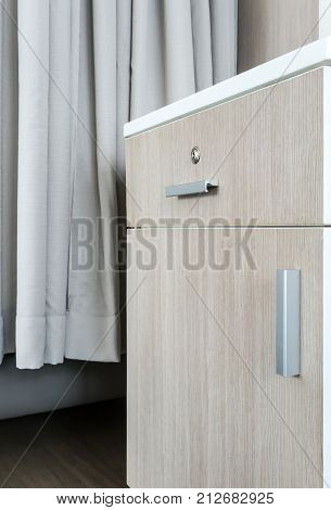 Small Wooden Cabinet With Silver Metal Handle And White Fiber Top
