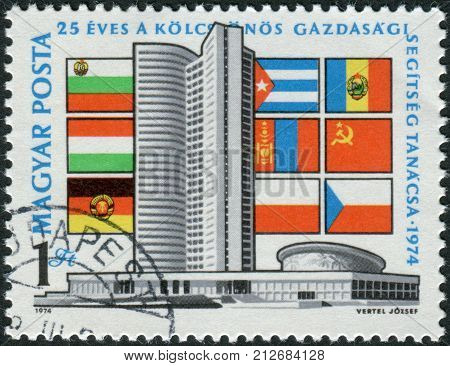 HUNGARY - CIRCA 1974: Postage stamp printed in Hungary dedicated to the 25th anniversary of Council of Mutual Economic Assistance depicted CMEA building in Moscow and the flags of the participating countries circa 1974