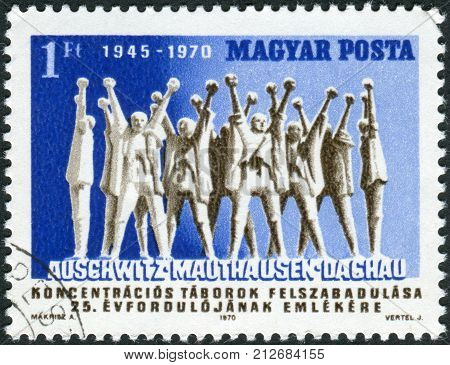 HUNGARY - CIRCA 1970: Postage stamp printed in Hungary dedicated to the 25th anniversary of Liberation of concentration camps shows monument in Mauthausen-Gusen concentration camp circa 1970