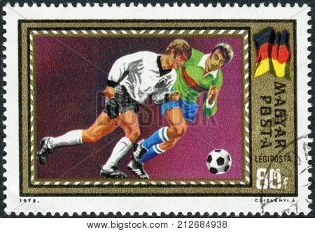 HUNGARY - CIRCA 1972: Postage stamp printed in Hungary dedicated in 1972 UEFA Football Europan Chamionship Belgium shows football players and the German flag circa 1972
