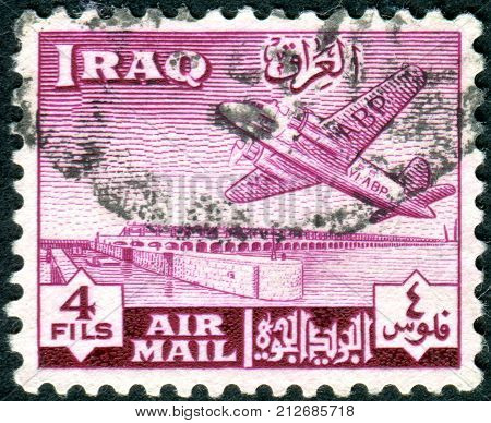 IRAQ - CIRCA 1949: A stamp printed in Iraq shows a airplane and Kut Barrage circa 1949