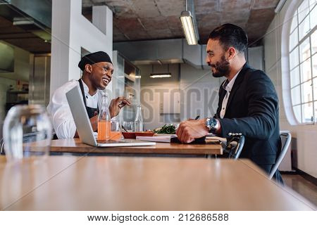 Restaurant Manager Having A Conversation With Chef