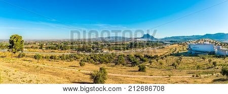 ANTEQUERA,SPAIN - OCTOBER 5,2017 - Panoramic view at the nature with museum building in Dolmens site in Antequera. The Antequera Dolmens Site is a UNESCO World Heritage site.