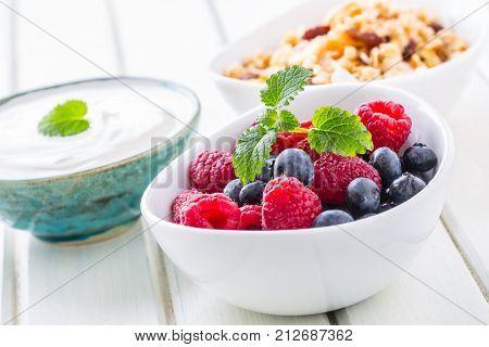 Muesli Yoghurt And Berries. Healthy Breakfast With Yogurt Granola And Fresh Fruit