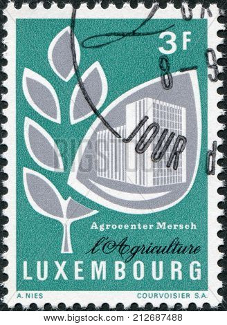 LUXEMBOURG - CIRCA 1969: A stamp printed in Luxembourg shows Grain and Mersch Agricultural Center circa 1969