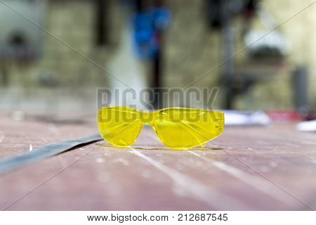 Protective goggles on a table in workshop