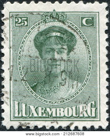LUXEMBOURG - CIRCA 1921: A stamp printed in Luxembourg shows Charlotte Grand Duchess of Luxembourg circa 1921