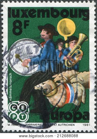 LUXEMBOURG - CIRCA 1981: A stamp printed in Luxembourg shows Hammelsmarsch (Sheep Procession) circa 1981