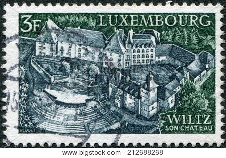 LUXEMBOURG - CIRCA 1969: A stamp printed in Luxembourg shows Castle and open-air theater Wiltz circa 1969