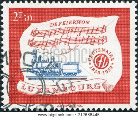 LUXEMBOURG - CIRCA 1959: A stamp printed in Luxembourg is dedicated to Centenary of Luxembourg's railroads shows Locomotive A1A n2 of 1859 and Hymn circa 1959