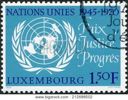 LUXEMBOURG - CIRCA 1970: A stamp printed in Luxembourg is dedicated to 25th anniversary of the United Nations shows UN Emblem circa 1970