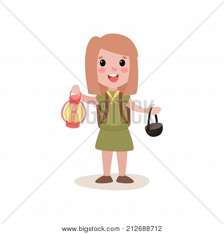 Funny little girl scout character holding red coleman lantern and black cauldron in hands. Kid dressed in khaki costume and yellow tie. Cartoon vector illustration in flat style isolated on white.