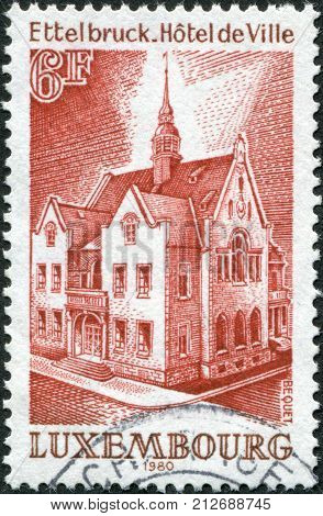 LUXEMBOURG - CIRCA 1980: A stamp printed in Luxembourg shows Ettelbruck Town Hall circa 1980