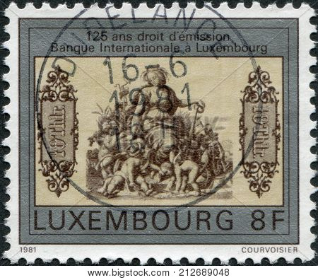 LUXEMBOURG - CIRCA 1981: A stamp printed in Luxembourg, is dedicated to the 125th anniversary of the International Bank of Luxembourg, represented the first banknote, circa 1981
