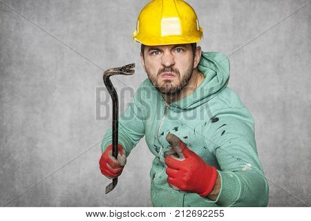 Disgruntled Worker Threatens With A Crowbar And Shows A Finger