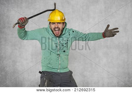 A Mad Worker Hits A Crowbar With A Safety Helmet