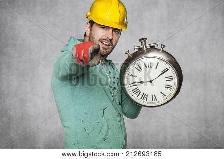 Worker Keeps The Clock And Points To You