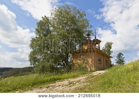 Rural landscape with a chapel. Chapel of the Assumption of the Mother of God in the village Markovskaya, Verhovazhskogo district, Vologda region, Russia