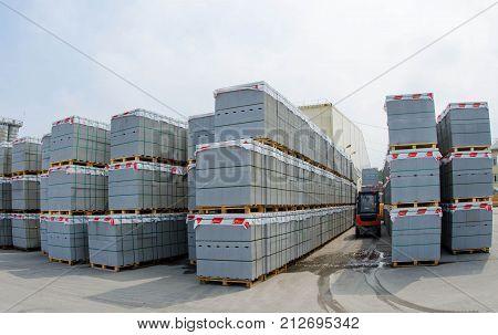 Forklift trucks in stock concrete blocks in outdoor