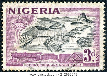 NIGERIA - CIRCA 1953: Postage stamp printed in the Nigeria (British colony) depicted Jebba Bridge over Niger River circa 1953