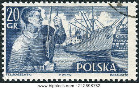 POLAND - CIRCA 1956: Postage stamp printed in Poland shows a Dock worker and SSPokoj circa 1956